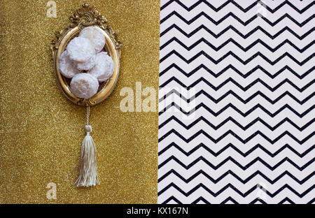 Homemade vanilla and jam cookies, on vintage picture frame or trail, on chevron background with copy space - Stock Photo