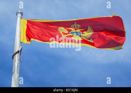 Montenegrin flag in Citadel on the Old Town of Budva city on the Adriatic Sea coast in Montenegro - Stock Photo