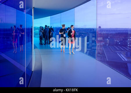 Visitors enjoy Your Rainbow panorama of Aarhus at Aros Art Museum. The museum is the second most visited in Denmark. - Stock Photo