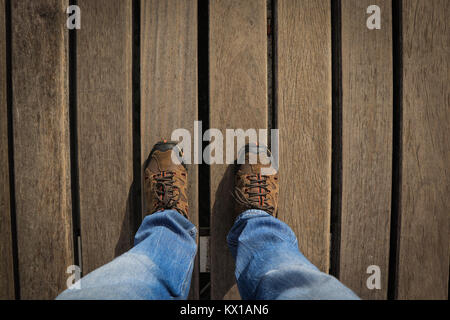 Top view from Young man with sneakers and jeans in a woods floor. Adventure shoes. - Stock Photo