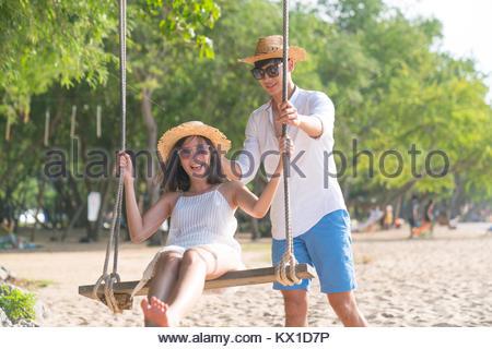 Couple on paradise beach resort sharing honeymoon - Stock Photo