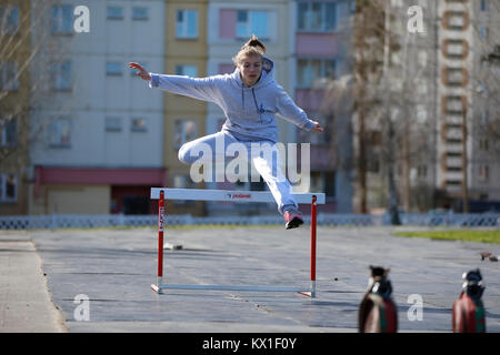 Belarus, Gomel, 21 April 2017. Open lesson on fire fighting. The athlete jumps over the barrier.Physical education - Stock Photo