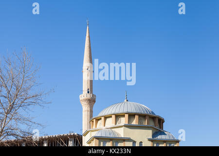 The dome and minaret from Haci Mehmet Turgay Mosque in Manavgat, Turkey.  The mosque is in Antalya province. - Stock Photo