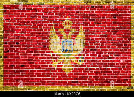 Flag of Montenegro painted on brick wall, background texture - Stock Photo