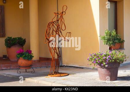 ESCAMPLERO, SPAIN - OCTOBER 31, 2017: Pilgrim statue in front of the bar - Stock Photo