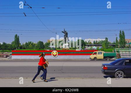 Tiraspol, the capital of Pridnestrovye (Transnistria), officially part of Republic of Moldova: Young women passing - Stock Photo