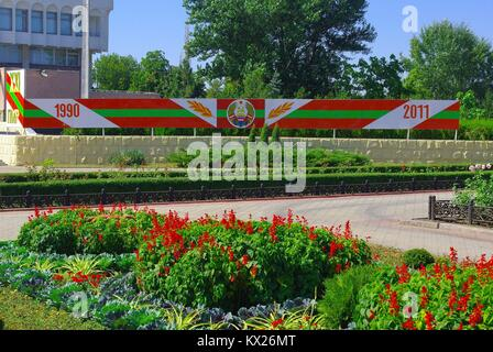 Tiraspol, the capital of Pridnestrovye (Transnistria), officially part of Republic of Moldova: Flowers and coat - Stock Photo