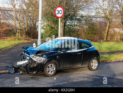 Crashed Car beside Speed Limit Sign - Stock Photo