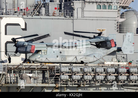 Bell Boeing MV-22 Osprey tilt rotor aircraft from the United States Marine Corps  on the deck of Untied States Stock Photo