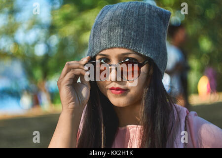 Close up of girl wearing sunglasses. - Stock Photo
