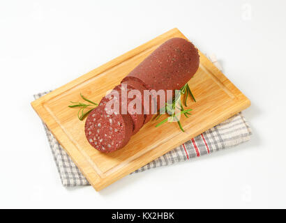 sliced blood sausage on cutting board - Stock Photo