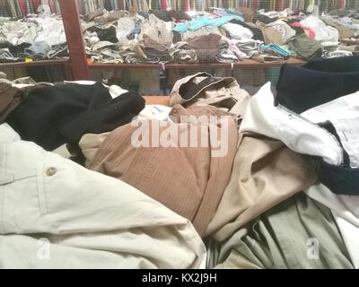 The Secondhand clothes in the market - Stock Photo