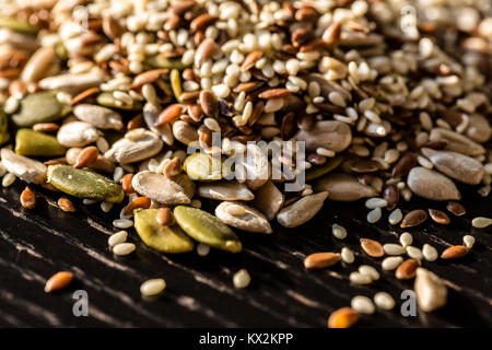 Spices: Mixed seeds - pumpkin, sesame, sunflower, flax. Healthy eating. - Stock Photo