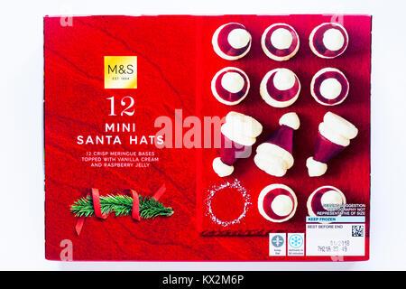Box of M&S 12 mini Santa hats - crisp meringue base topped with vanilla cream and raspberry jelly - Stock Photo