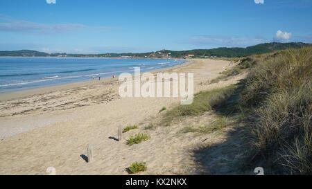 O GROVE, SPAIN - SEPTEMBER 16, 2017: Beautiful beach Playa de A Lanzada close to O Grove, coast of Galicia on September - Stock Photo