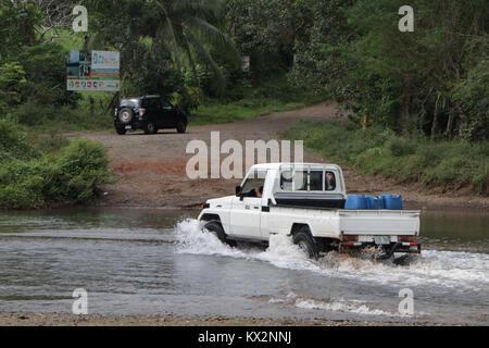 Car crossing river near Drake Bay Costa Rica Osa Peninsula