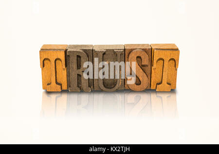 Trust Word Block Letters on Isolated White Background - Stock Photo