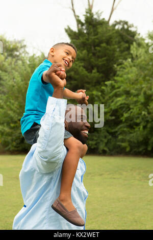 Father and son playing outside. - Stock Photo