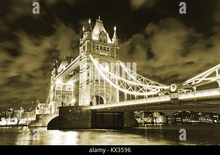 View of Tower Bridge in London at night. - Stock Photo