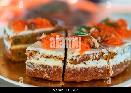 Freshly decorated organic carrot cake - Stock Photo