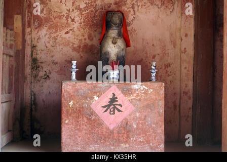 Statue of dog in japanese bridge in old Hoi An, Vietnam - Stock Photo