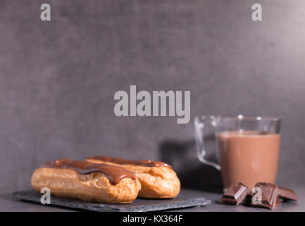 home backed eclairs with hot coco - Stock Photo