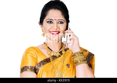 Indian Traditional Marathi Woman Housewife Talking On Mobile Phone - Stock Photo
