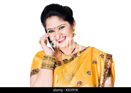 Happy Indian Traditional Marathi Lady Housewife Talking Phone - Stock Photo