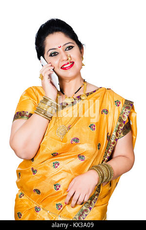 Indian Traditional Marathi Woman Housewife Talking On Cell Phone - Stock Photo
