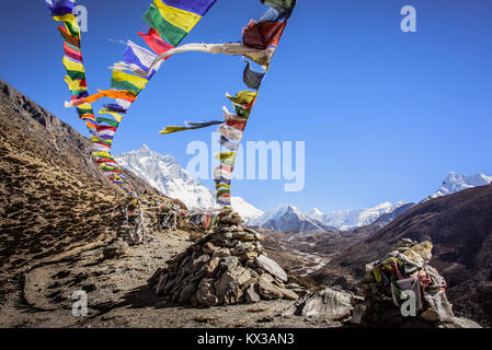 Prayer flags guiding the way to Everest Base Camp Nepal - Stock Photo