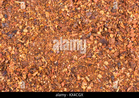 Pile crushed red cayenne pepper, dried chili flakes and seeds isolated on white background - Stock Photo