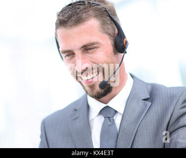 Happy  man working at callcenter, using headset - Stock Photo