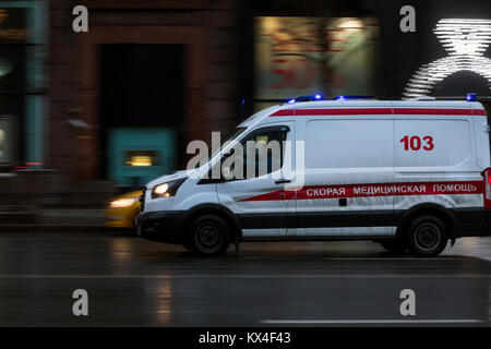 Ambulance rides to a patient on Tverskaya Street in center of Moscow,Russia - Stock Photo