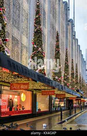 Oxford Street, London,House of Fraser department store,shop with Christmas decorations,xmas trees and January sale - Stock Photo
