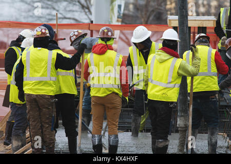 Group of builders on a construction site - Stock Photo