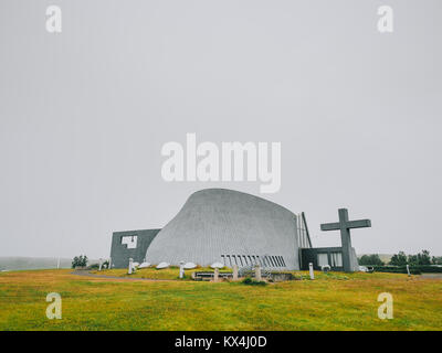 Modern church, concrete construction, with a large cross, new parish church, Bloendus, Blonduos, Iceland - Stock Photo