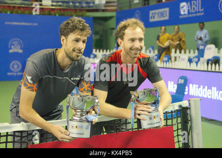 Pune, India. 6th January 2018. Robin Haase and Matwe Middelkoop of the Netherlands, the doubles winners, pose with - Stock Photo