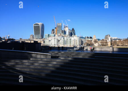 London UK. 7th January 2018. People walk along London Riverside on a sunny cold day as temperatures drop to 4 degrees - Stock Photo