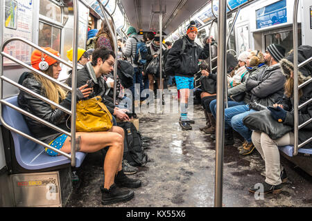 New York, USA, 7 Jan 2018.  Participants in the 17th Annual 'No Pants Subway Ride' ride the New York City subway. - Stock Photo