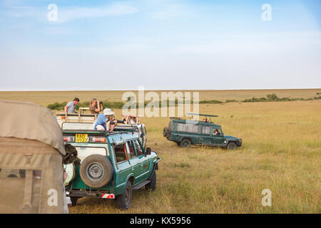 Tourists in safari cars on the African savannah - Stock Photo