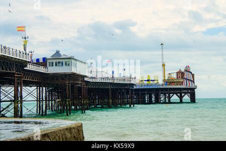 Brighton pier on the English coast in the spring - Stock Photo