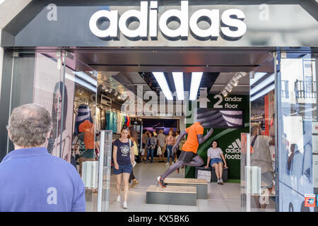 Lisbon Portugal Baixa Chiado historic center Rua Augusta pedestrian mall promenade Adidas Megastore front entrance - Stock Photo
