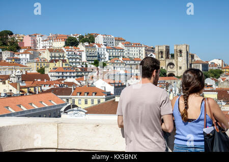 Lisbon Portugal Baixa Chiado historic center Arco da Rua Augusta arch viewing platform man woman couple city skyline - Stock Photo