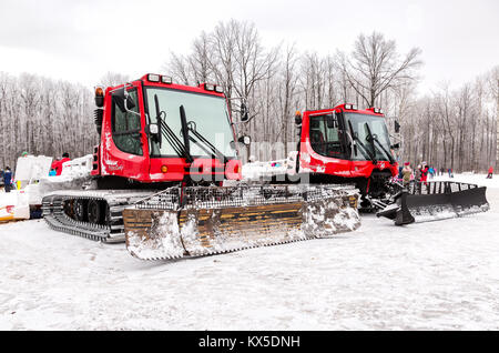 Samara, Russia - January 6, 2018: Snow groomer machines at the winter park. Used to prepare slopes for skiers - Stock Photo