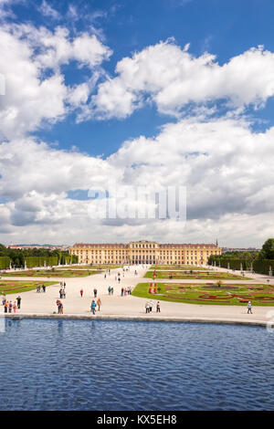 Famous Schonbrunn Palace with lake in the garden, Vienna, Austria - Stock Photo