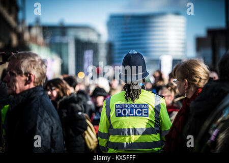 Metropolitan Police Officer on duty during a protest march in London - Stock Photo