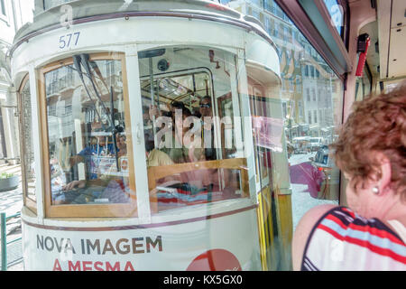 Lisbon Portugal historic center centre Largo da Se vintage tram trolley woman view through window Portuguese Europe - Stock Photo