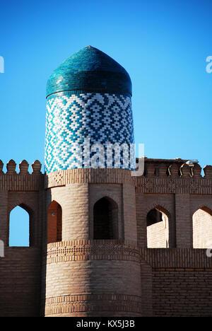 Walled walls with tower, Khiva - Uzbekistan - UNESCO World Heritage site - Stock Photo