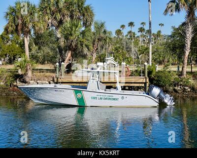 Florida Fish and Wildlife Commission State Law Enforcement boat tied to dock. Crystal River, Citrus County, Florida, - Stock Photo