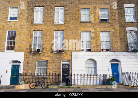 Angel, London, UK - January 2018: Facade of Edwardian Victorian restored residential houses in yellow bricks with - Stock Photo